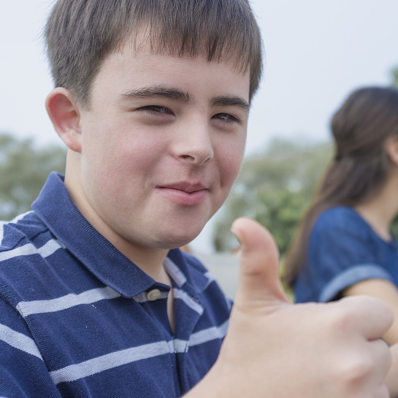 boy giving the thumbs-up gesture